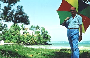 Sir Arthur strolling near the Island of Taprobane, in a still from the video series Arthur C. Clarke's Mysterious World. Courtesy of Arthur C. Clarke, 1989.